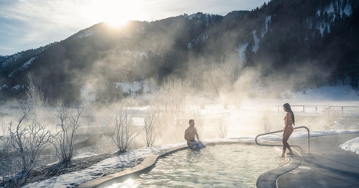 People getting into a hot spring pool in the mountains.