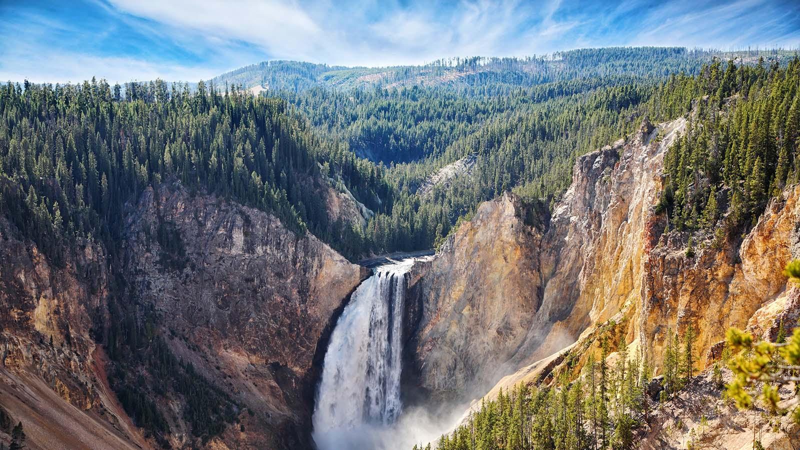 waterfall in scenic mountain range