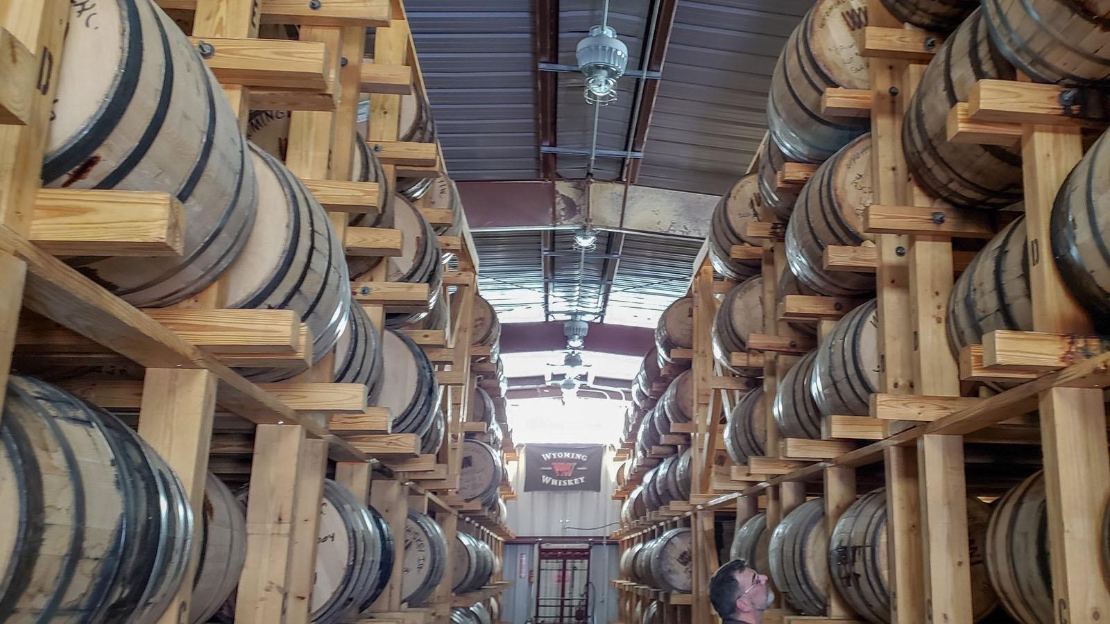 Whiskey barrels on shelves