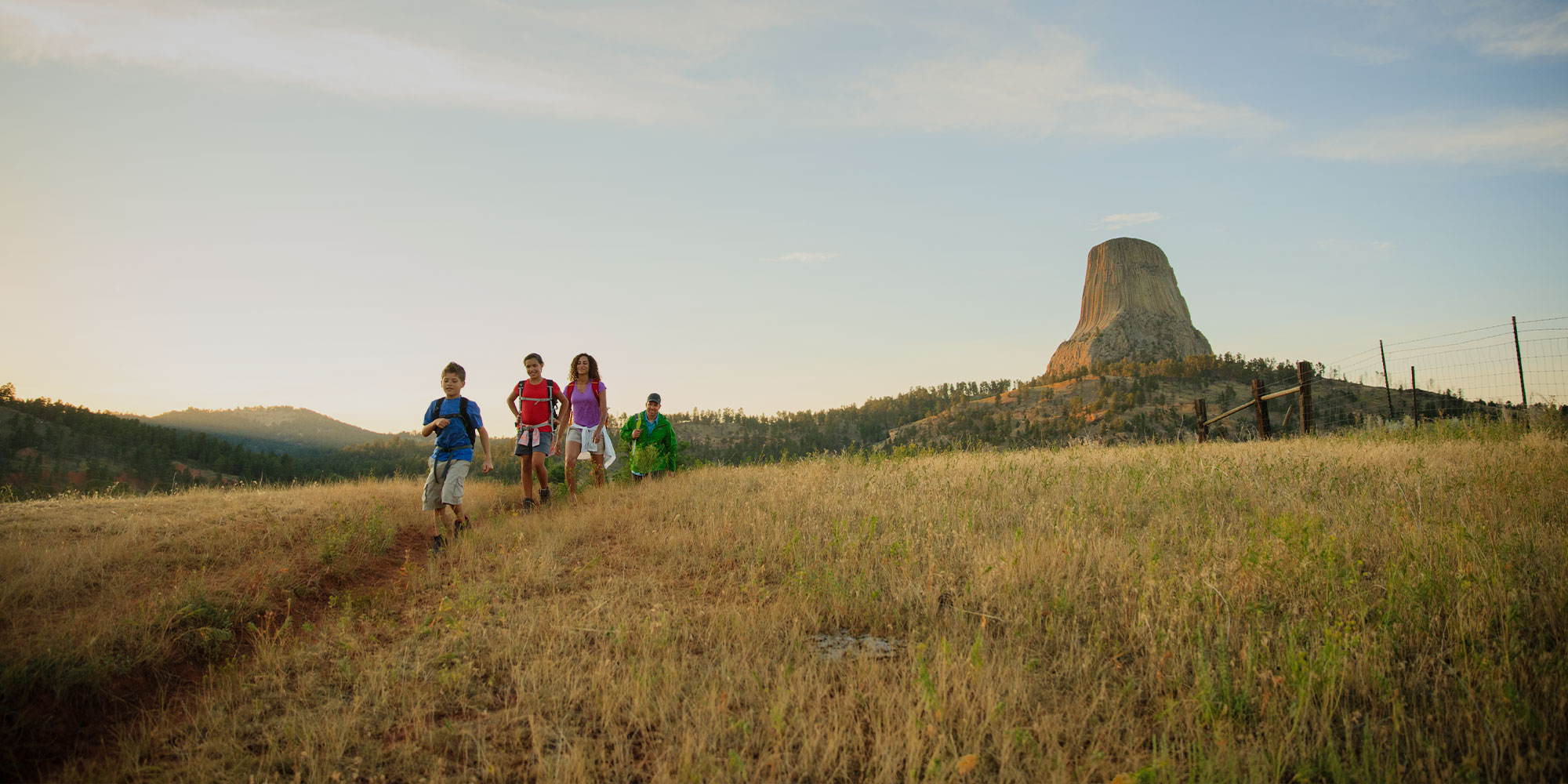 Kids and family hiking outside Devils Tower