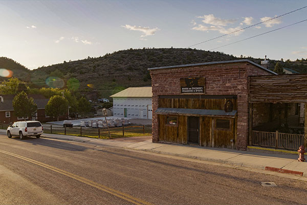 The red brick and wood facade of Miners and Stockmen's Steakhouse and Spirits in Hartville, Wyoming