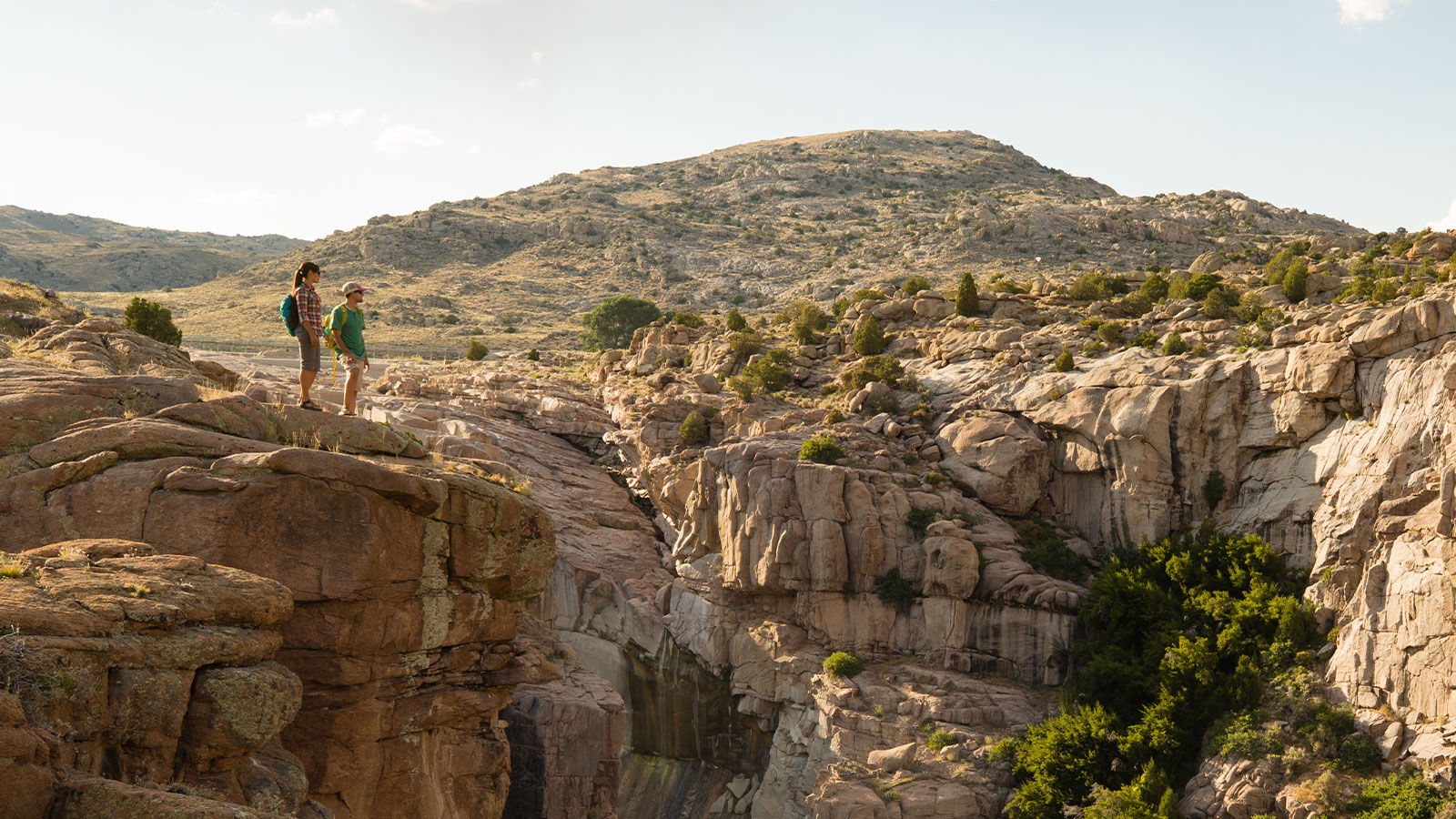 Hiking couple on cliff over looking Footbridge river canal