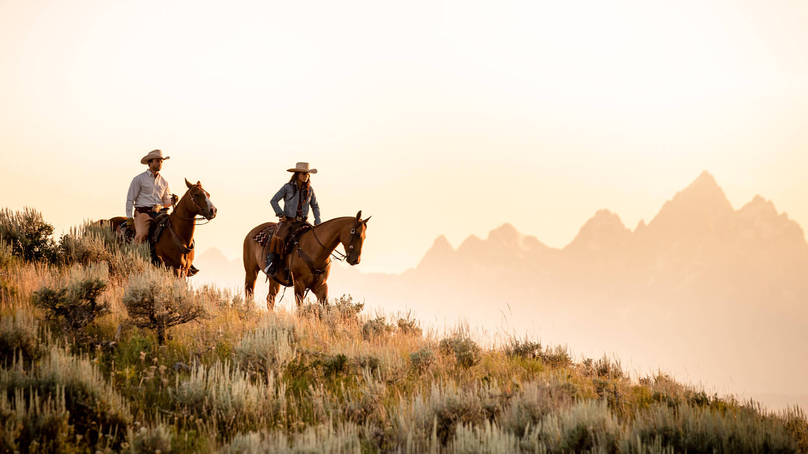 Horseback riders on hillside