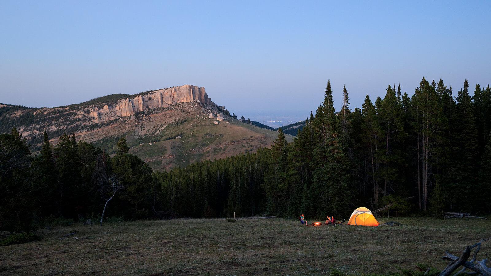 Campsite setup below mountainside