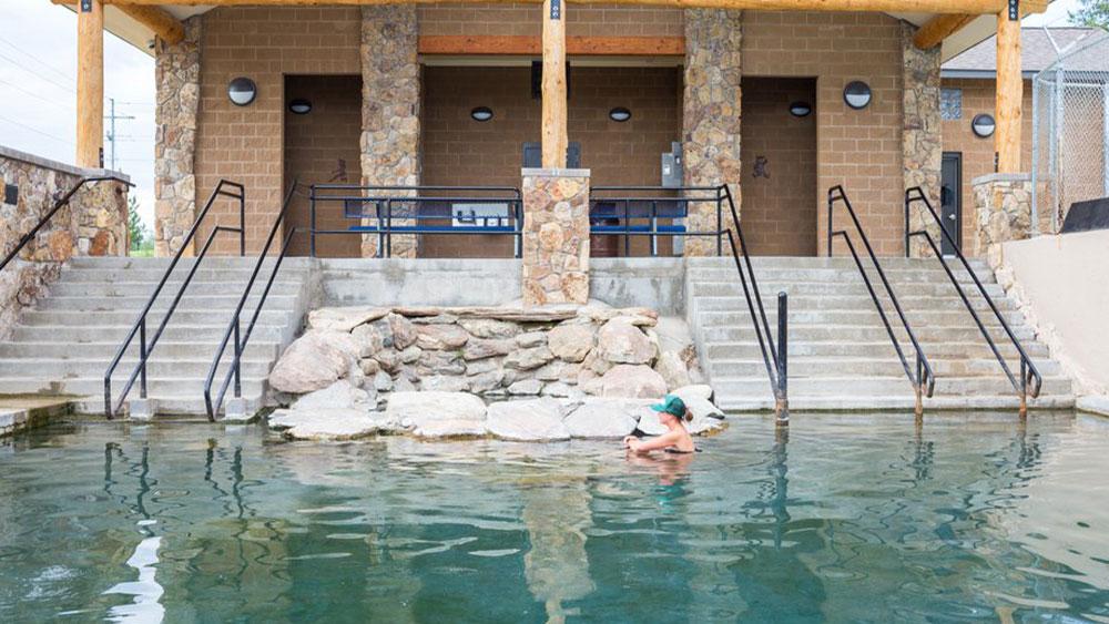 Bather in hot springs pool