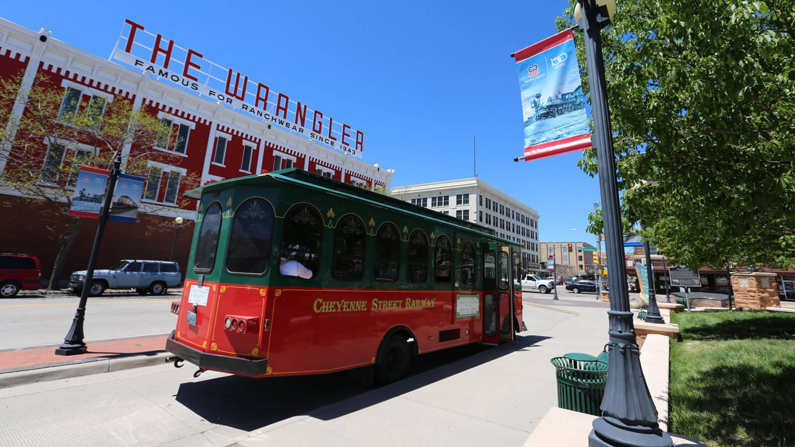 downtown trolley in front of building