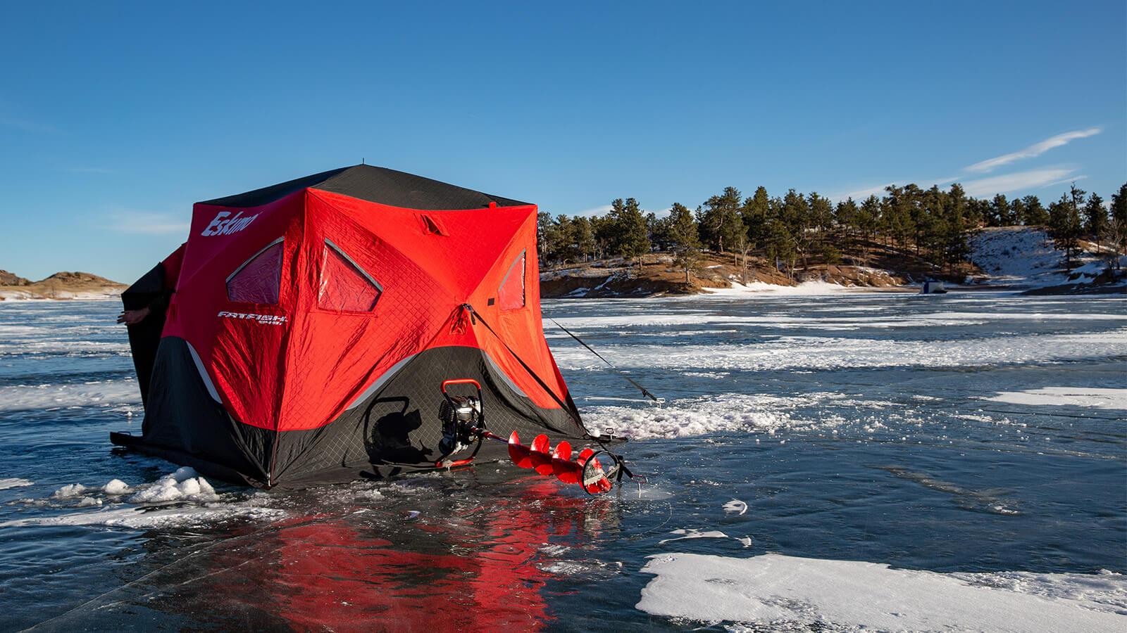 Ice fishing tent on lake