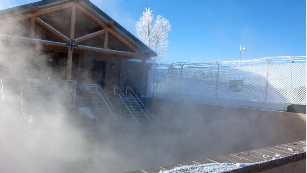 steam rising over hot springs pool