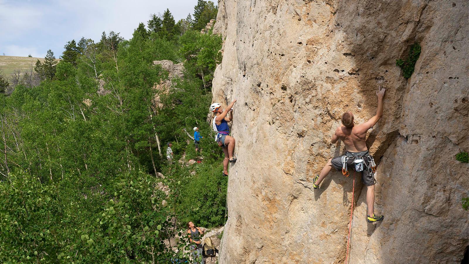 Climbers scaling rock