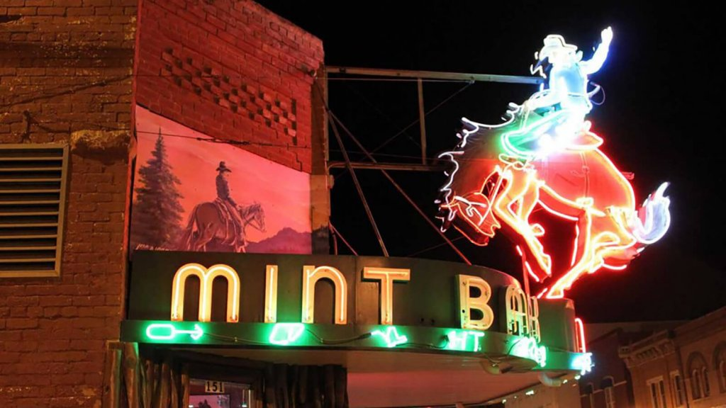 neon sign above saloon
