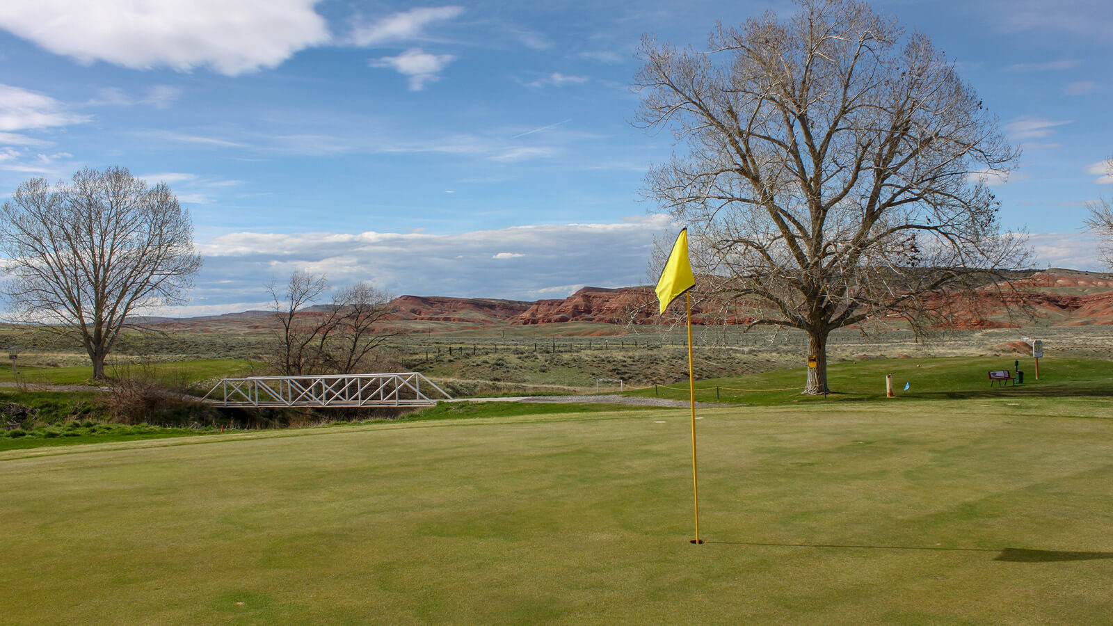 Putting green against mountain backdrop