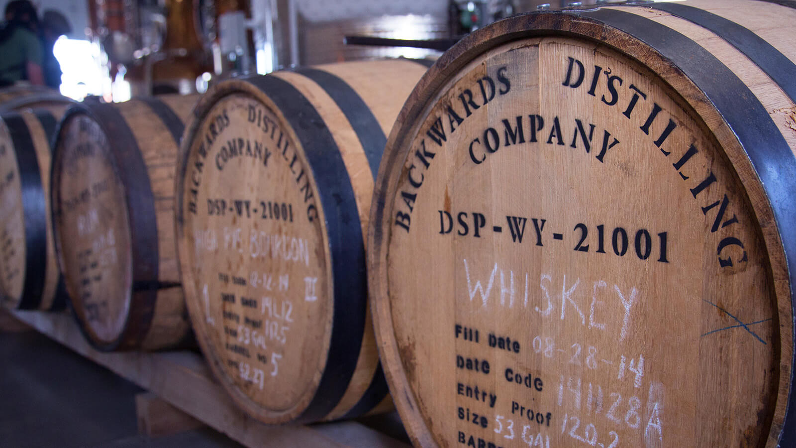whiskey barrels lined up