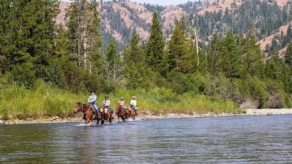 Horseback riders on river side