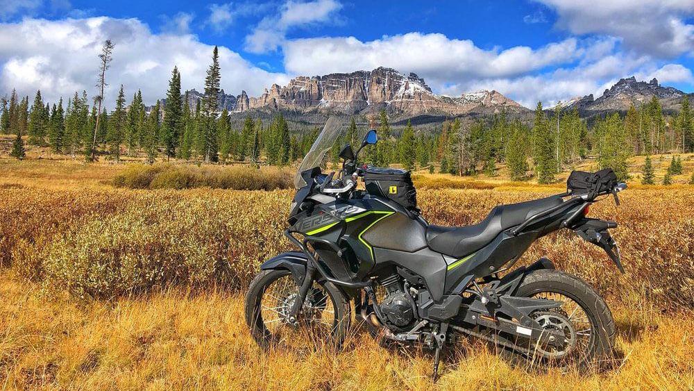 motorbike in field looking at mountain range