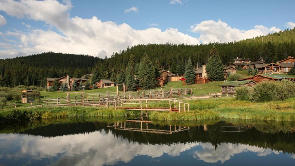 guest ranch buildings next to lake