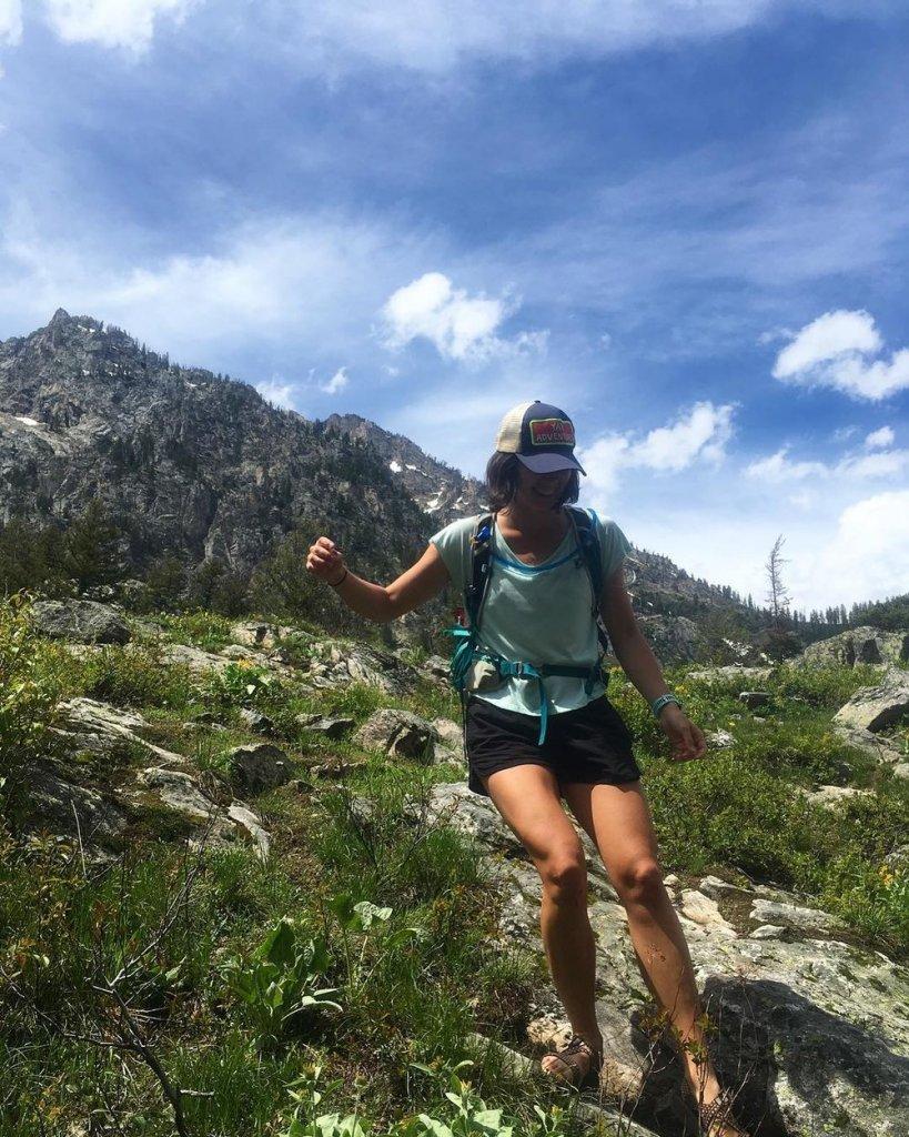 Woman walking down hiking trail