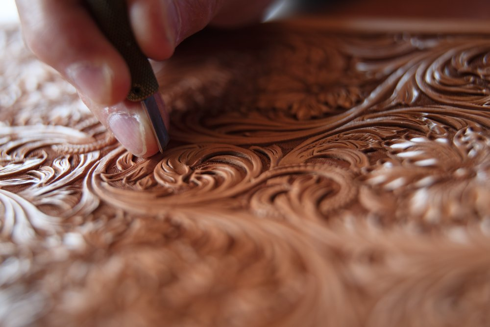 hand carving details in leather