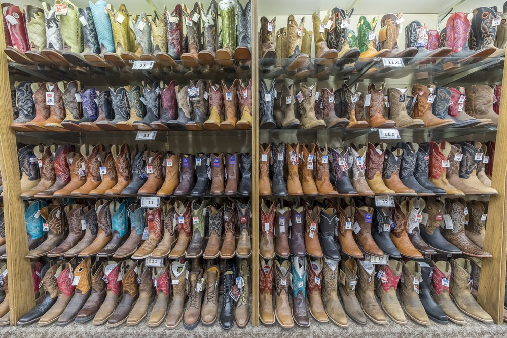 shelves of cowboy boots.