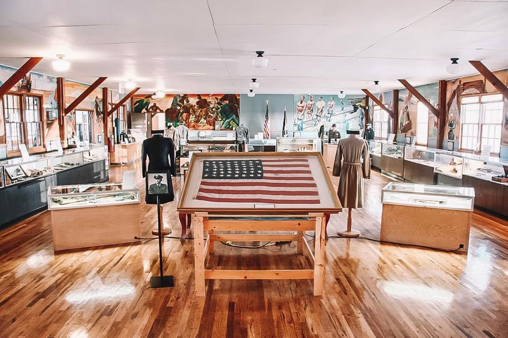 Interior of museum with a display of the United States Flag.