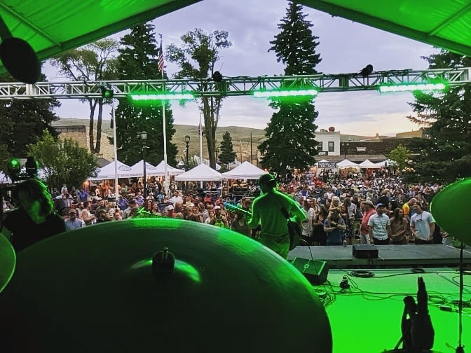 view of concert audience from stage behind drums